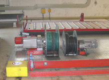 Several transfer cars. Power supply by Motorized Cable Reels. Laminate and flake board production.